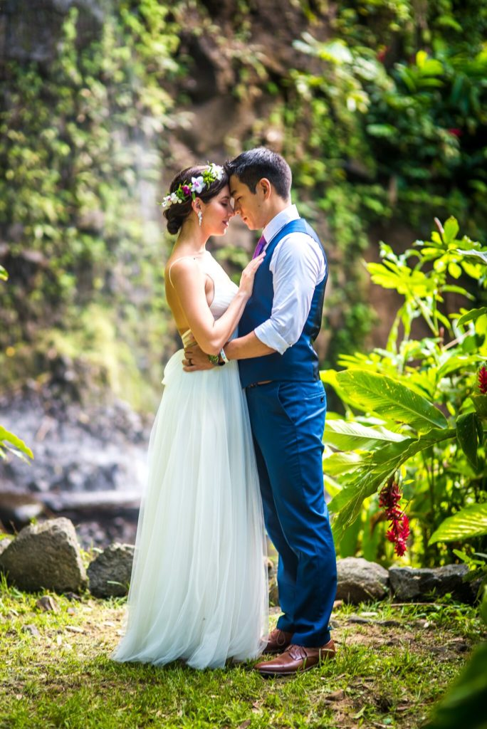 Close up waterfall wedding on Kauai.